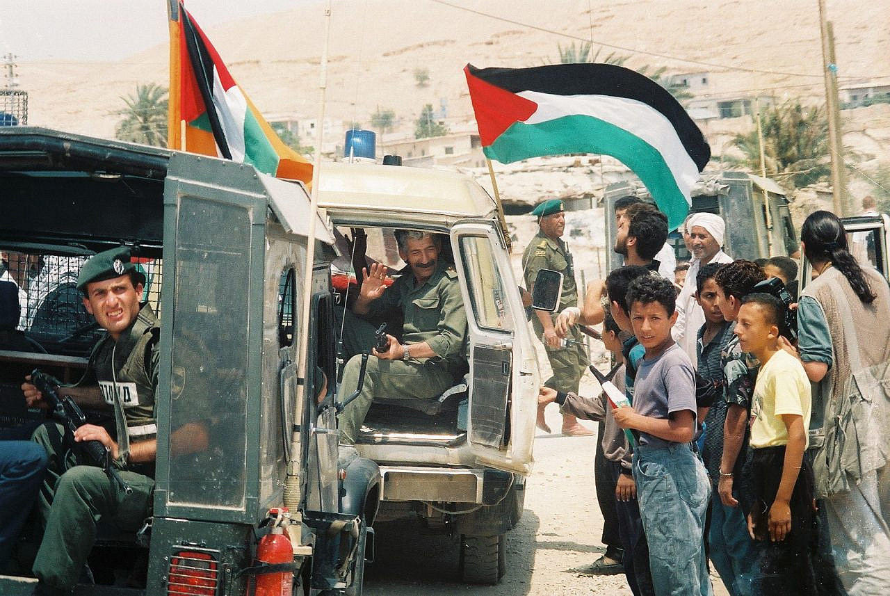 Palestinians celebrate the entrance of Palestinian police officers into Jericho, May 13, 1994. Jericho was one of the first cities in the occupied West Bank handed over to the Palestinian Authority in accordance with the Oslo Accords. (Yossi Zamir/Flash 90)
