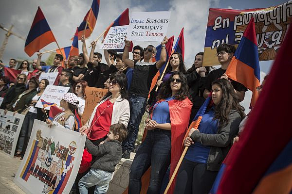 Members of the Armenian community of Jerusalem hold signs and Armenian flags as they protest in front of the Israeli Foreign Affairs Ministry against Israel's weapon sales to Azerbaijan, April 14, 2016. (Hadas Parush/Flash90)