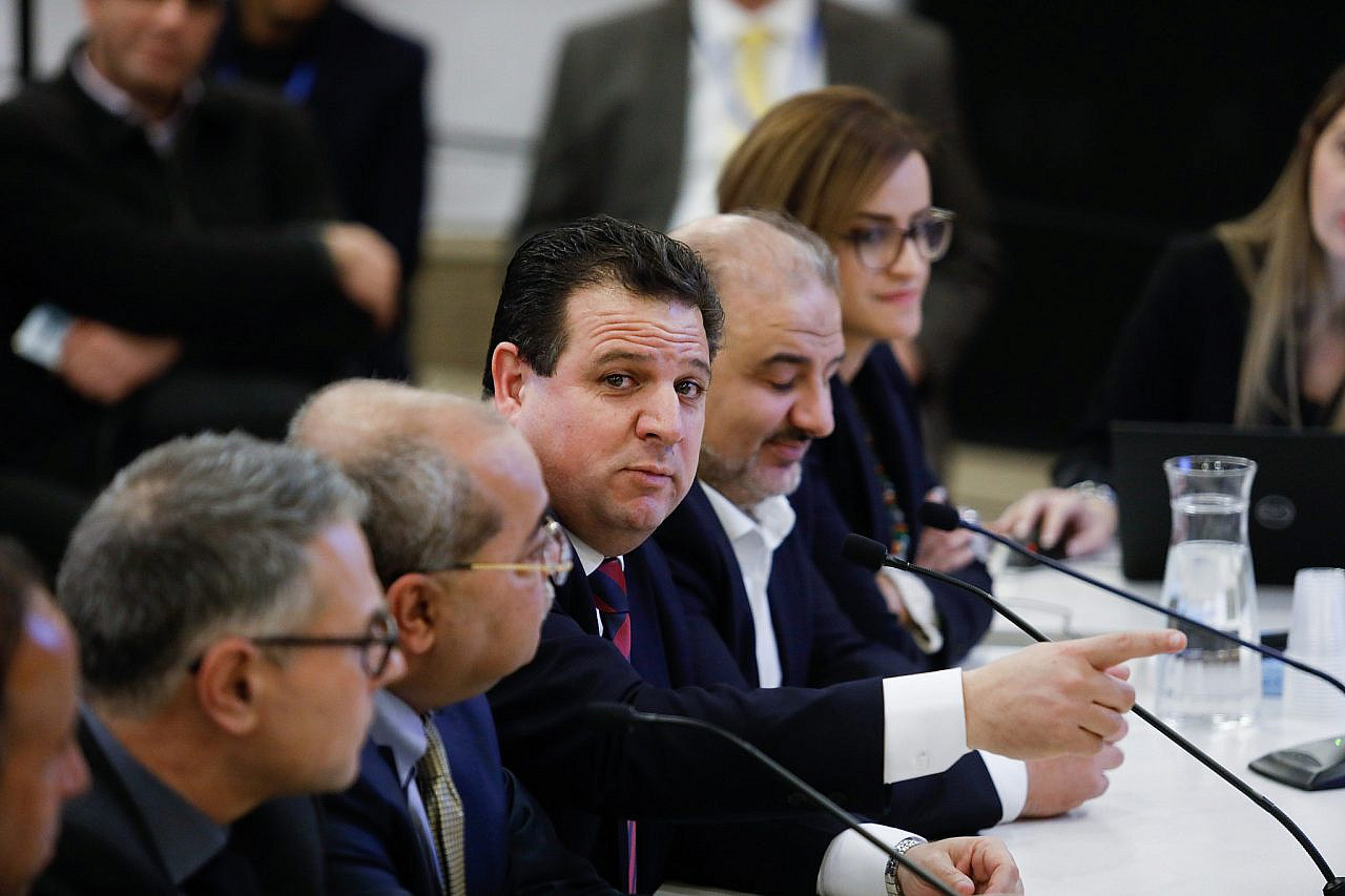 Joint List head Ayman Odeh presents the party list to the election committee at the Knesset ahead of the national election, Jerusalem, January 15, 2020. (Olivier Fitoussi/Flash90)