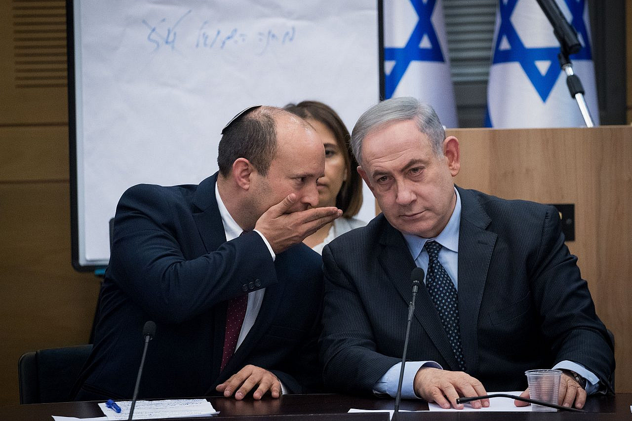 Israeli Prime Minister Benjamin Netanyahu speaks with Israeli minister of Defense and leader of the Yamina party Naftali Bennett during a meeting with the heads of the right-wing parties, March 4, 2020. (Yonatan Sindel/Flash90)
