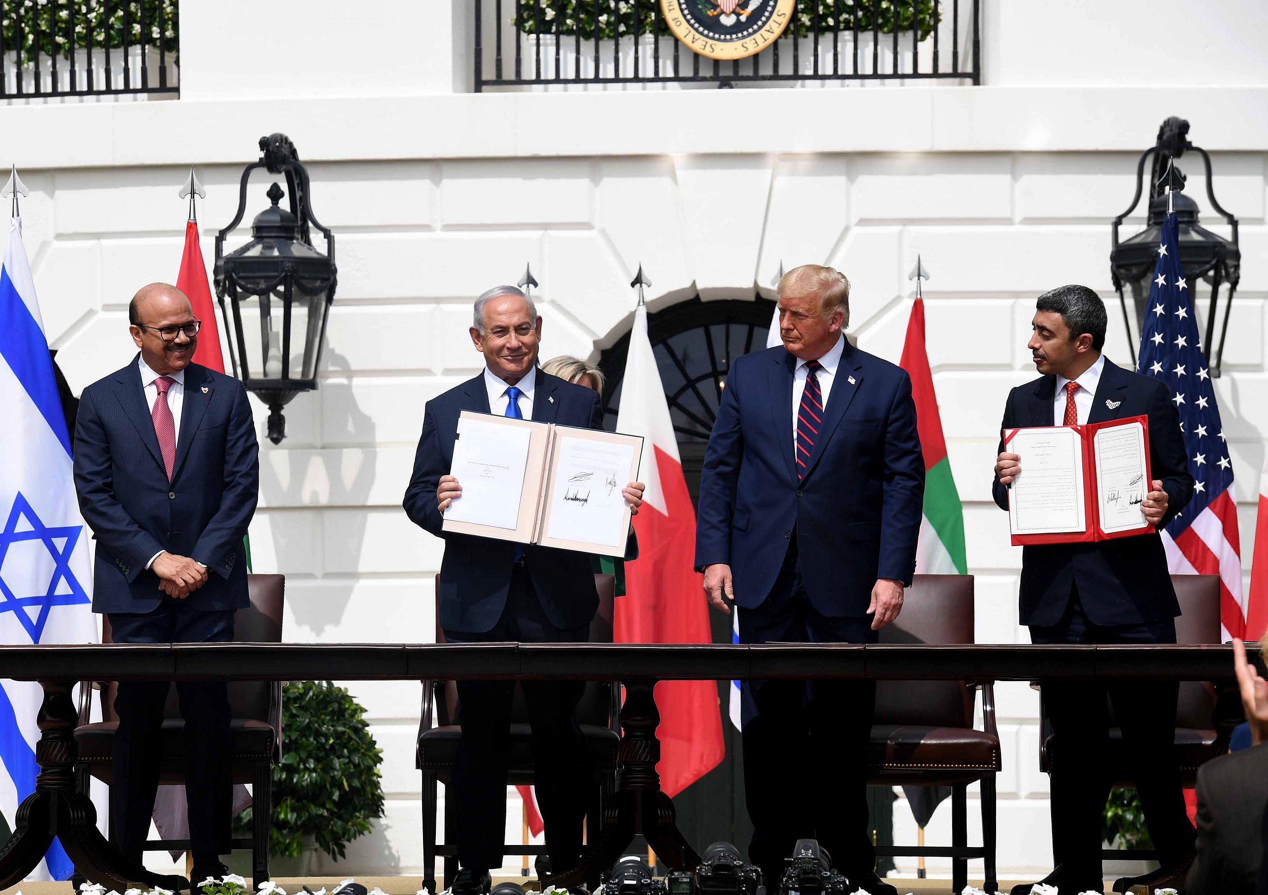 Israeli Prime Minister Benjamin Netanyahu, U.S. President Donald Trump, Minister of Foreign Affairs and International Cooperation of the UAE Abdullah bin Zayed Al Nahyan and Abdullatif bin Rashid Al-Zayani, Minister of Foreign Affairs of Bahrain attend the Abraham Accords Signing Ceremony at the White House in Washington, USA, September 15, 2020. (Avi Ohayon/GPO)