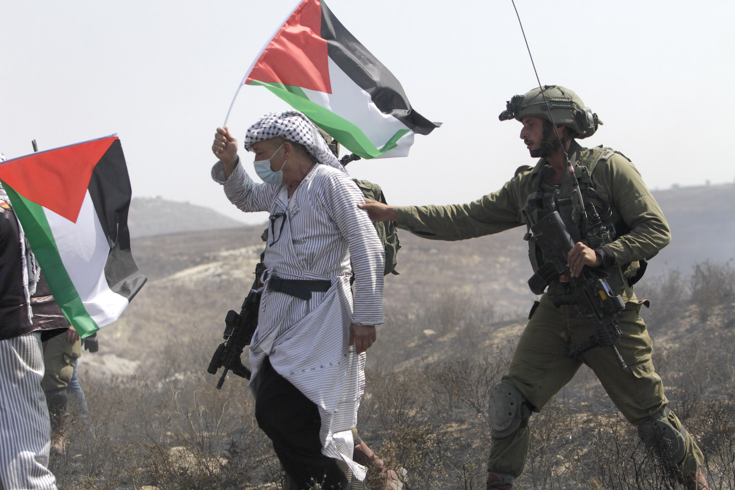 Israeli soldiers seen during a protest by Palestinians against settlers in the West Bank village of Asira al-Qibliya, near the settlement of Yitzhar, September 18, 2020. (Nasser Ishtayeh/Flash90)