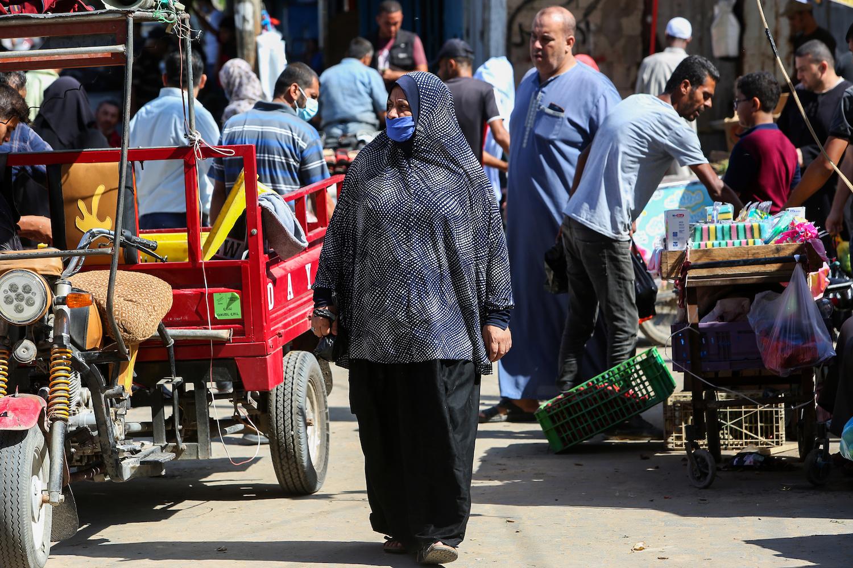 Palestinians wearing face masks in the market in Rafah, Gaza, on October 13, 2020. (Abed Rahim Khatib/Flash90)