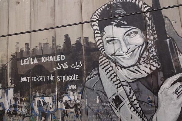Graffiti depicting Leila Khaled on the separation wall in Bethlehem, the occupied West Bank, May 27, 2012. (Bluewind/Wikimedia)