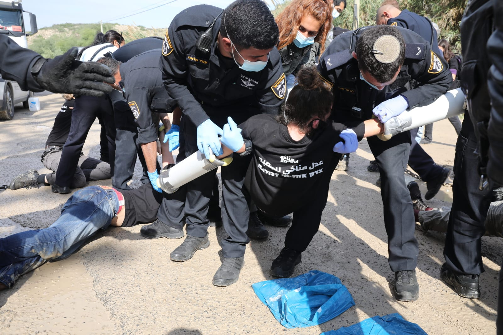 Israeli police arrest climate activists outside the HeidelbergCement quarry in the occupied West Bank during a protest against government plan to expand the quarry and build an industrial zone nearby, November 22, 2020. (Oren Ziv)