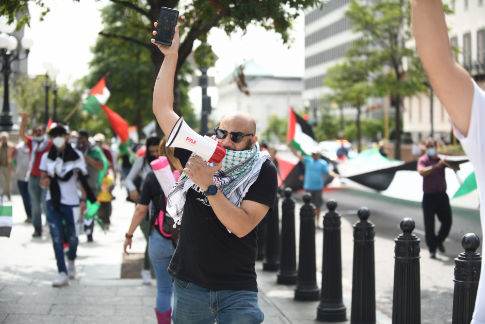 Palestinian activists and allies protest the signing of the Abraham Accords between Israel, the United Arab Emirates, and Bahrain, outside the White House, Washington DC, September 16, 2020. (Gili Getz)