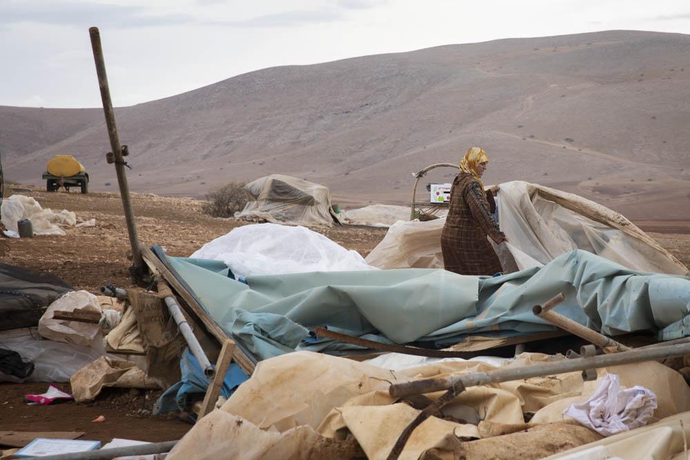 Fadwa Abu Awwad Awawdeh walks among the debris of an Israeli demolition in the Palestinian community of Humsa al-Fuqa, in the occupied West Bank, November 4, 2020. (Oren Ziv/Activestills)