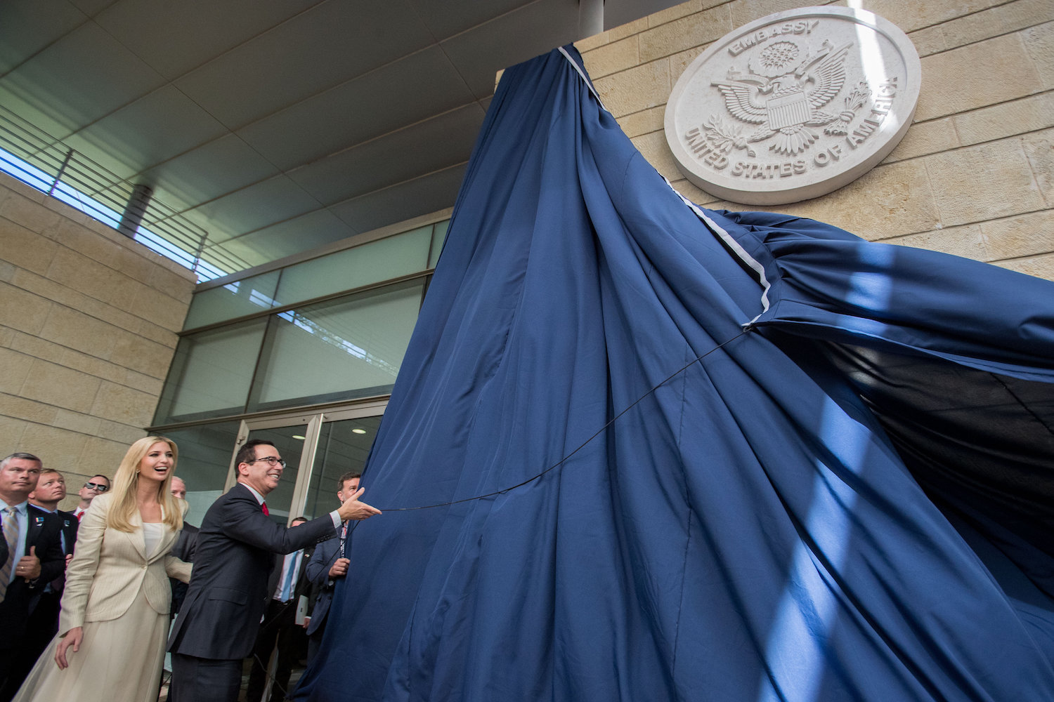 U.S. Secretary of the Treasury Steven Munchin and daughter of President Donald Trump, Ivanka Trump, reveal a dedication plaque at the official opening ceremony of the U.S. Embassy, Jerusalem, May 14, 2018. (Yonatan Sindel/Flash90)