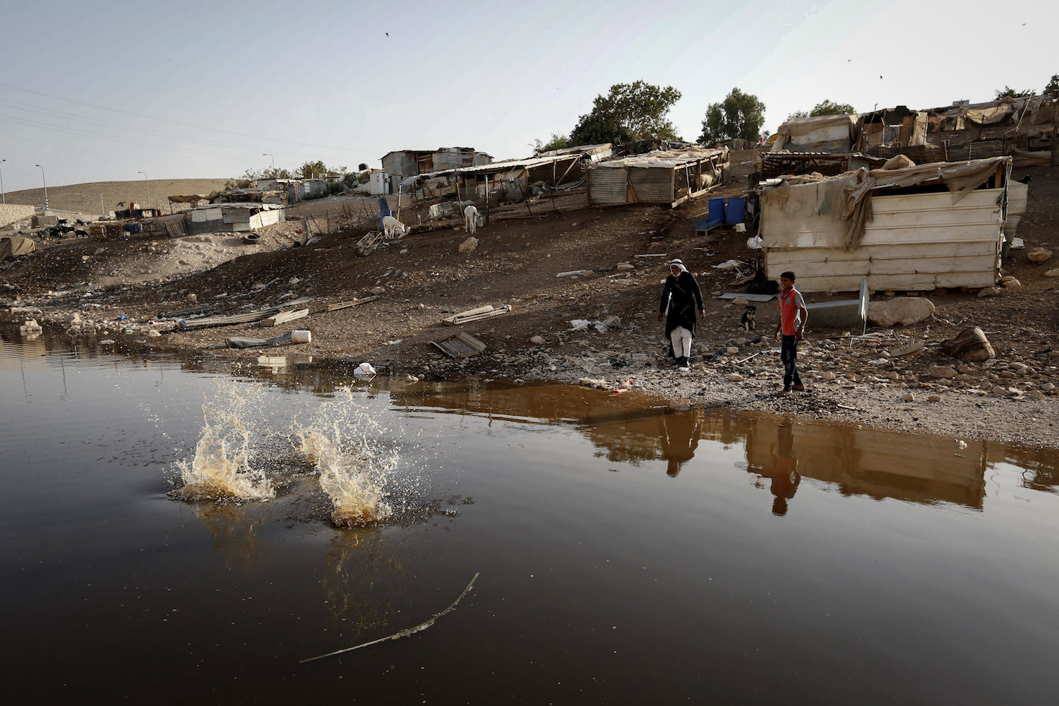 A wastewater pond is seen in the Palestinian Bedouin village of Khan al-Ahmar, which is slated for destruction by Israeli authorities, on October 2, 2018. (Wisam Hashlamoun/Flash90)