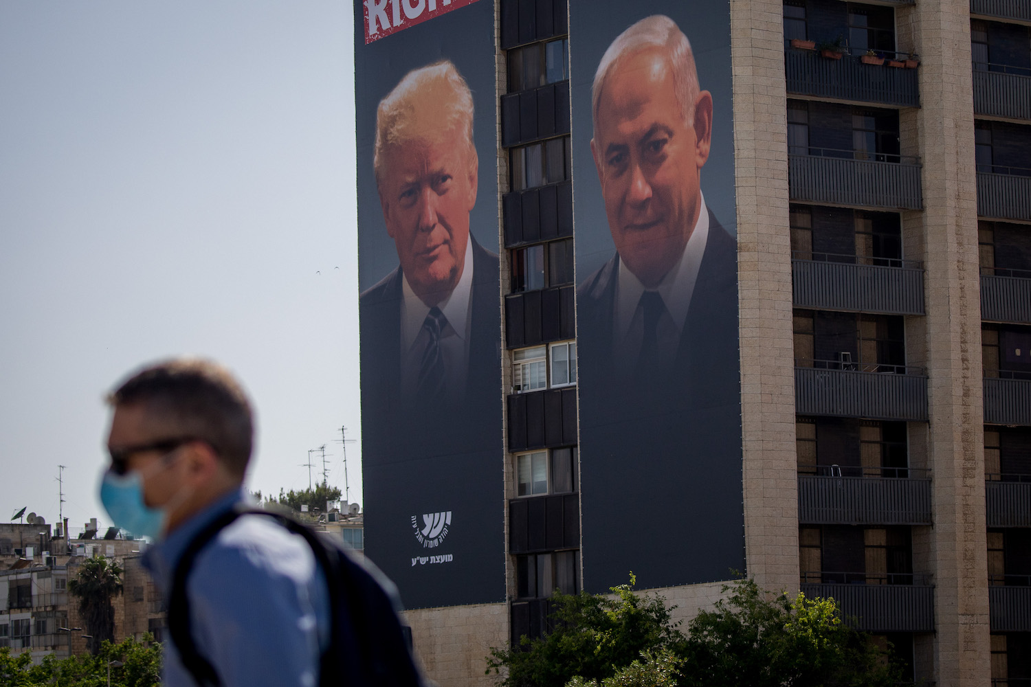 A large billboard depicting U.S. President Donald Trump and Israeli Prime Minister Benjamin Netanyahu, as part of a new campaign by the Yesha Council in support of annexation, Jerusalem, June 10, 2020. (Yonatan Sindel/Flash90)
