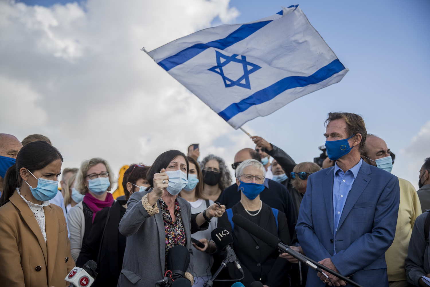 Right-wing Israelis hold a demonstration as European Union representatives deliver a press conference in the Jewish settlement neighborhood of Givat HaMatos, East Jerusalem, November 16, 2020. (Yonatan Sindel/Flash90)
