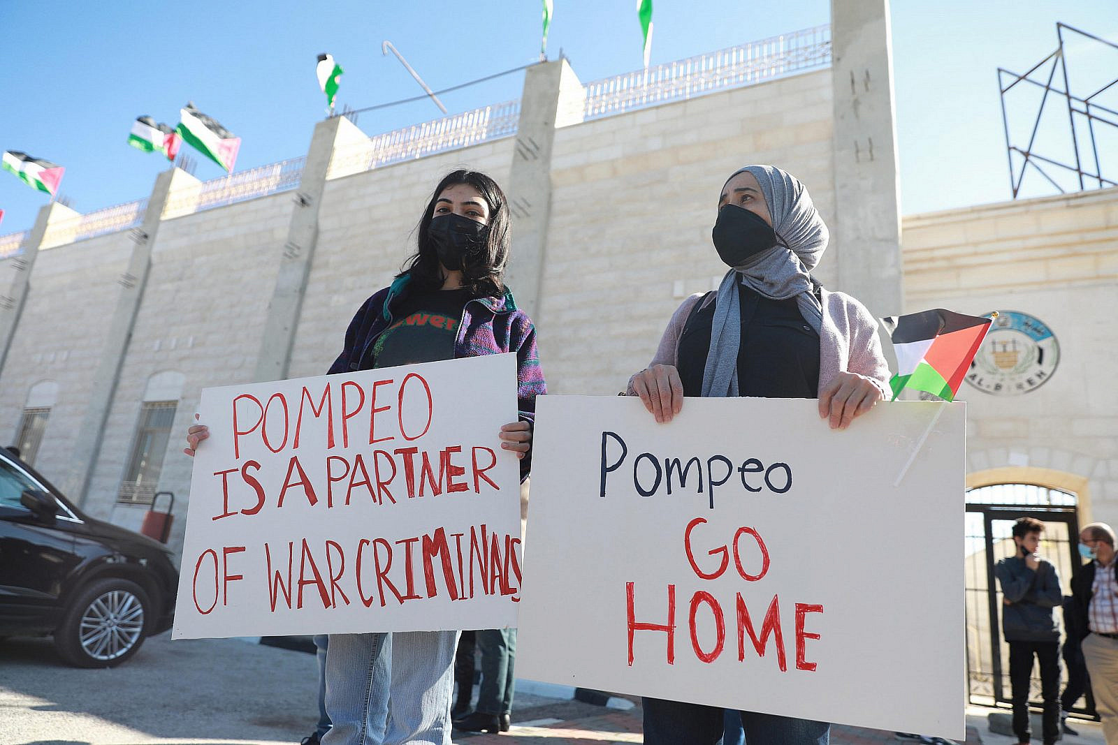 Palestinians protest against the visit of U.S. Secretary of State Mike Pompeo to the Jewish settlement of Psagot near the West Bank city of Al-Bireh, November 18, 2020. (Flash90)