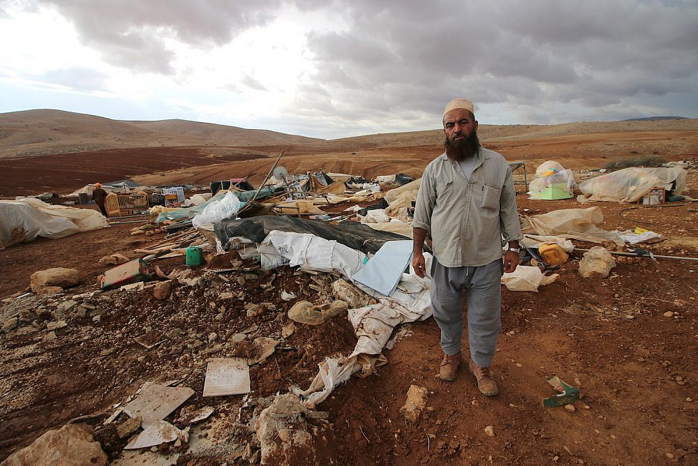 Abdul-Ghani Awawdeh is seen among the debris of an Israeli demolition in the Palestinian community of Humsa al-Fuqa, in the occupied West Bank, November 4, 2020. (Oren Ziv/Activestills)