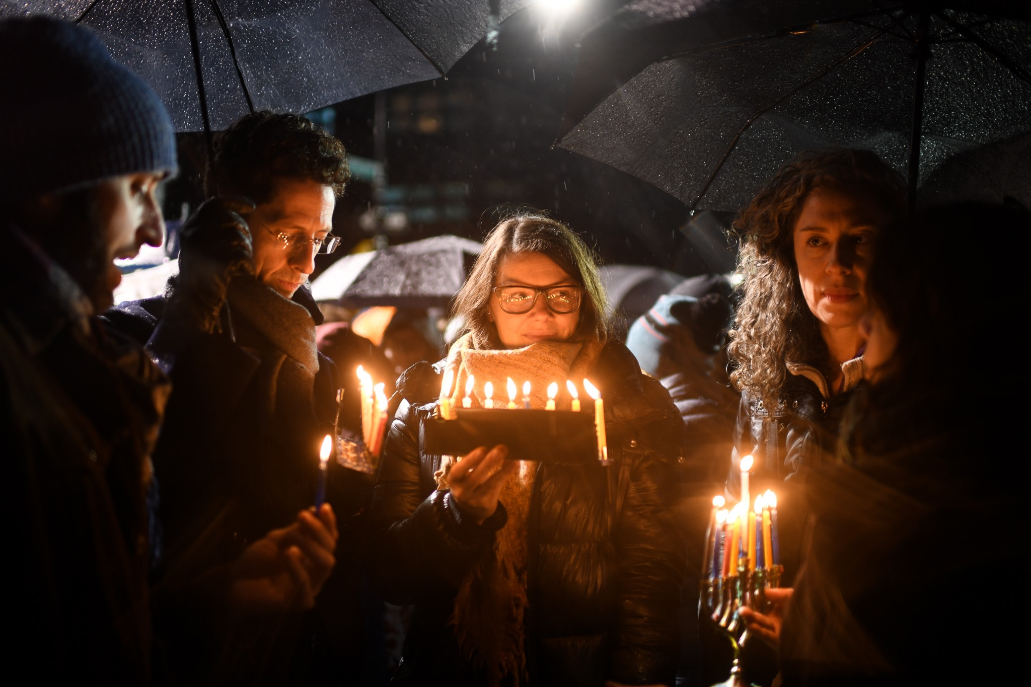 Jewish Americans light Hanukkah candles during a vigil that followed a wave of antisemitic attacks on the Jewish community in New York, December 30, 2019. (Gili Getz)