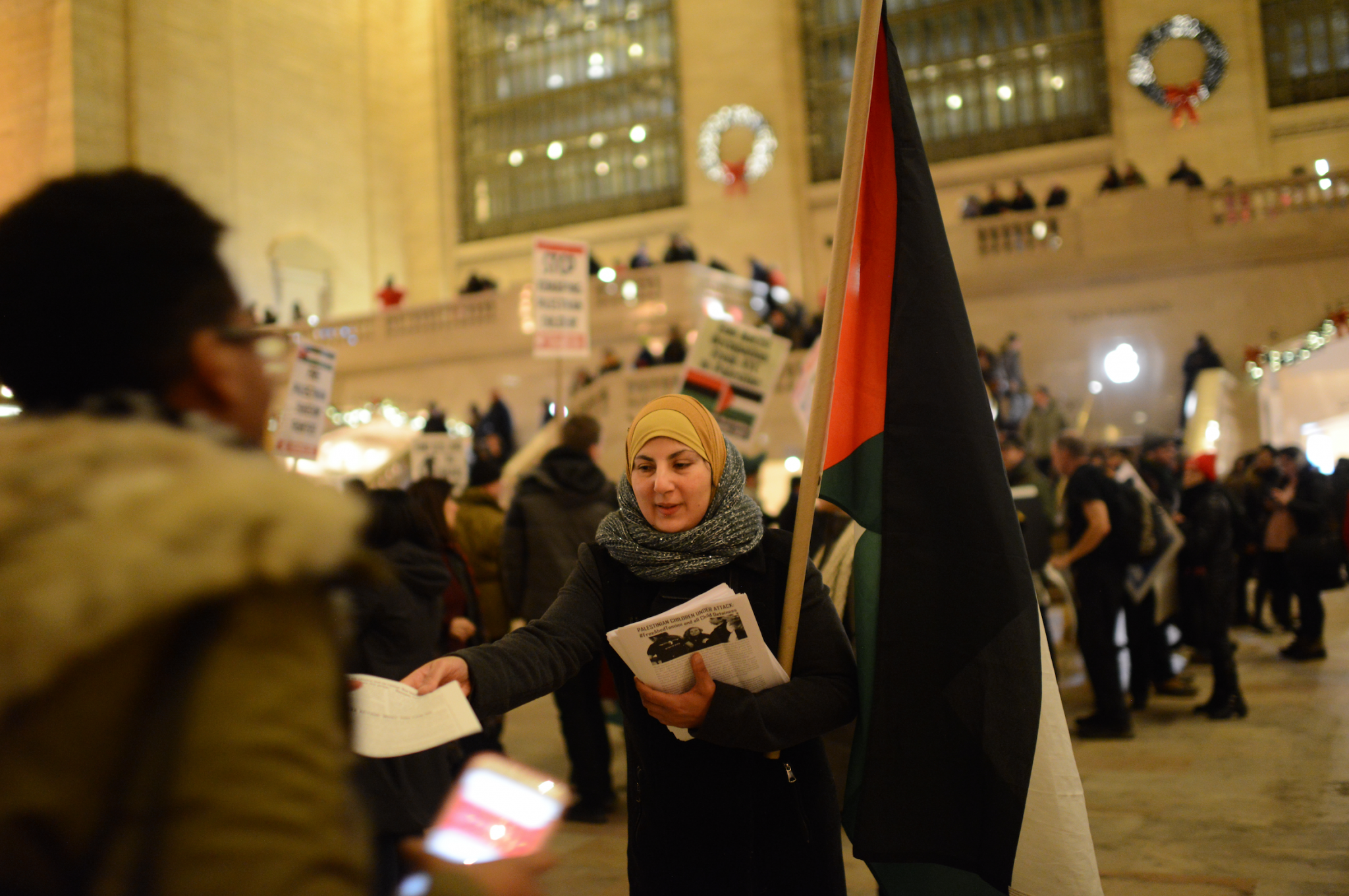 Palestinian activists protest in solidarity with Ahed Tamimi, Grand Central Station, New York City, January 5, 2018. (Gili Getz)