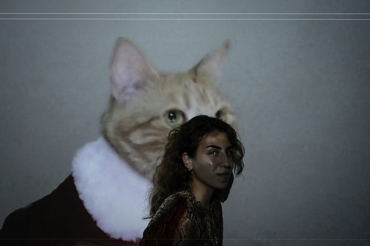 Palestinian designer Reem Kawasmi poses for a portrait on August 21, 2020 in the city of Bethlehem. (Samar Hazboun)