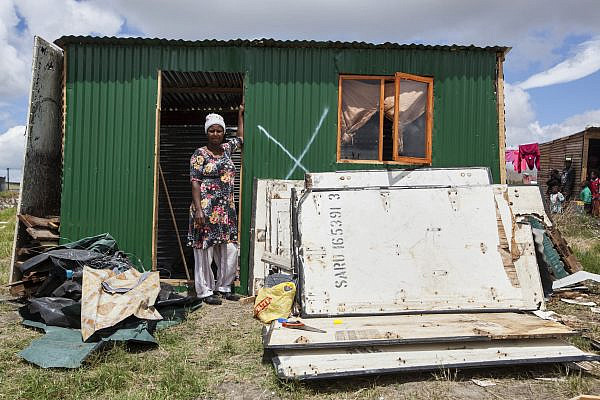 Demolished structures seen in Cape Town's Marikana community, after the city's Anti-Land Invasion Unit began demolishing structures erected on a plot of land by the Abahlali baseMjondolo shack dwellers movement, January 9, 2014 (Shachaf Polakow/Activestills.org)
