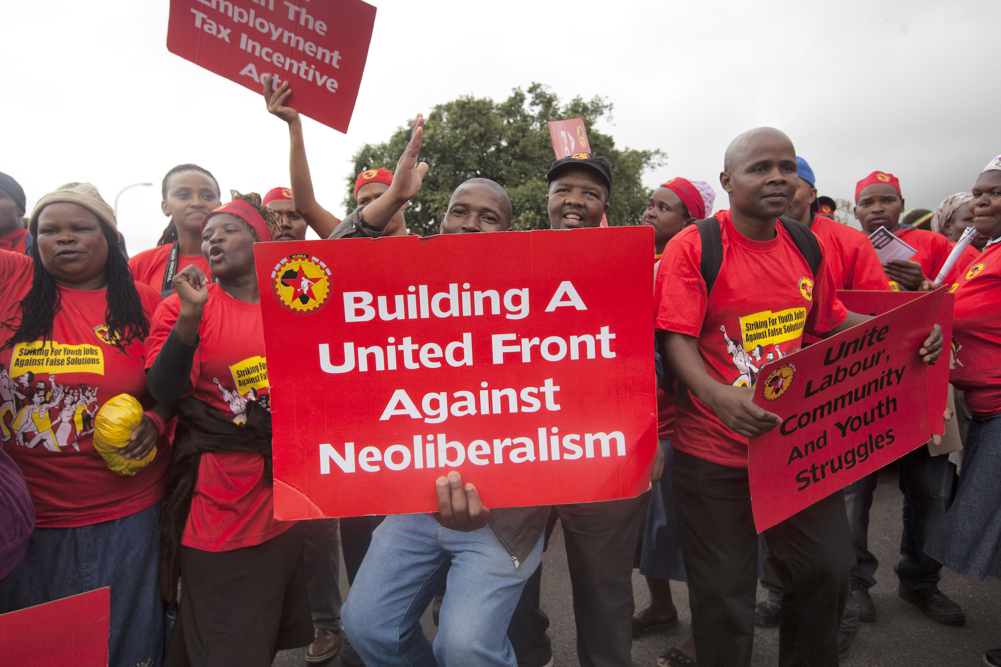 Members of the National Union of Metal Workers and their supporters march in central Cape Town during a general strike, March 19, 2014. (Shachaf Polakow/Activestills.org)