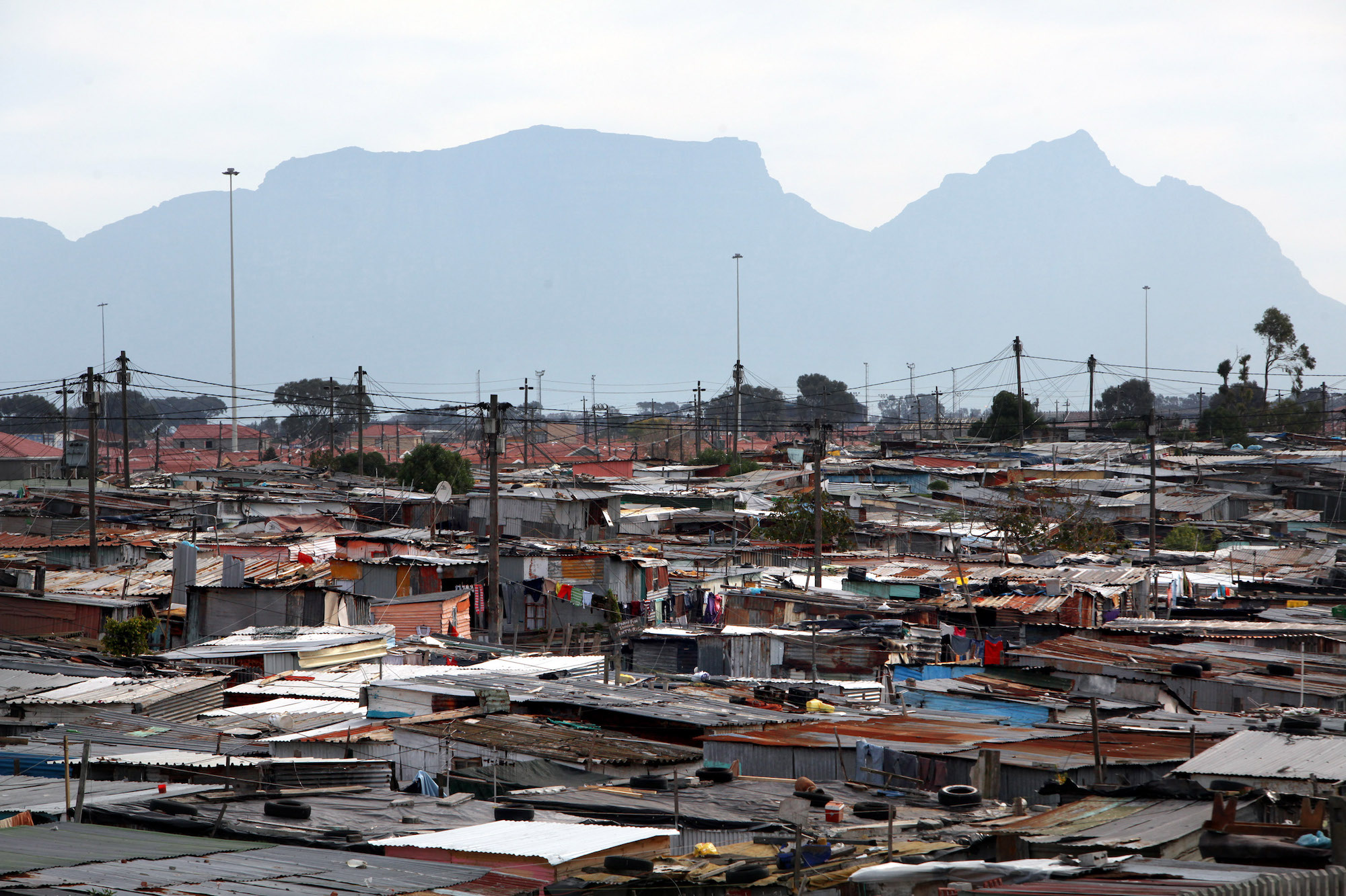 A view of Khayelitsha township, one of the largest townships in South Africa, with Table Mountain in the background, August 7, 2011. (Tess Scheflan/Activestills.org)