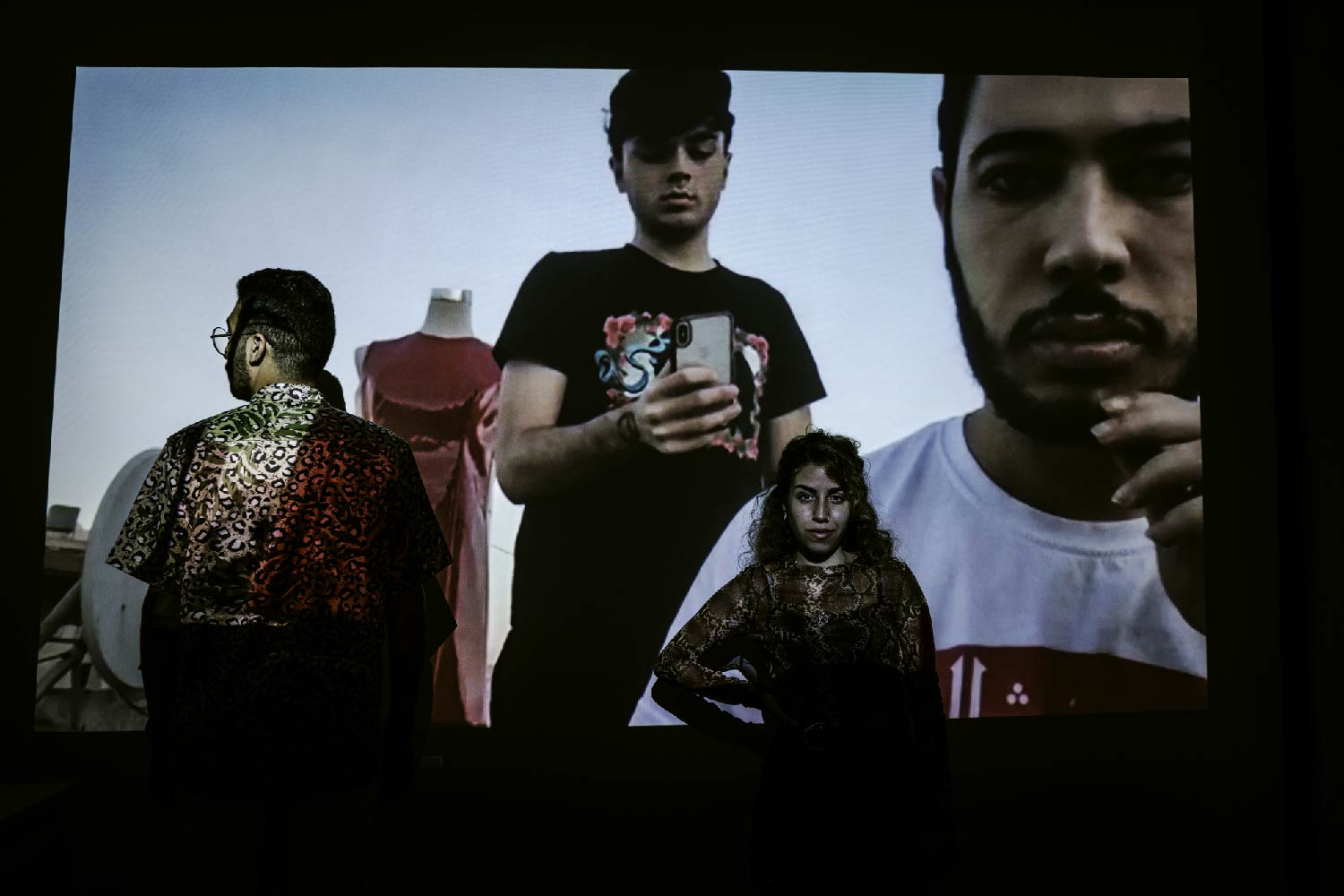 Members of tRASHY in Amman, Shukri Lawrence and Omar Braika, pose for a picture while being projected onto co-designers Reem Kawasmi and Luai Al-Shuaibi, in the city of Bethlehem on August 21, 2020. (Samar Hazboun)