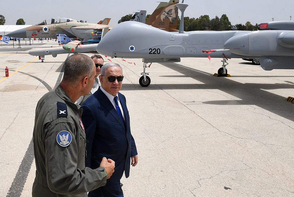 Prime Minister Benjamin Netanyahu meets with Base Commander Brigadier General Peleg Niago, during a visit to the Air Force base in Tel Nof to meet with foreign air force commanders, May 23, 2018. (Kobi Gideon/GPO)