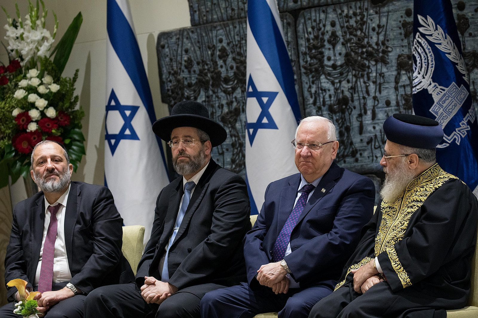 President Reuven Rivlin (center right) with Chief Ashkenazi Rabbi David Lau (center left), Sephardi Chief Rabbi Yitzhak Yosef (right) and Israeli Minister of Interior Affairs Aryeh Deri (left) at a swearing in ceremony for the Rabbinate Council at the President's residence in Jerusalem, October 24, 2018. (Yonatan Sindel/Flash90)