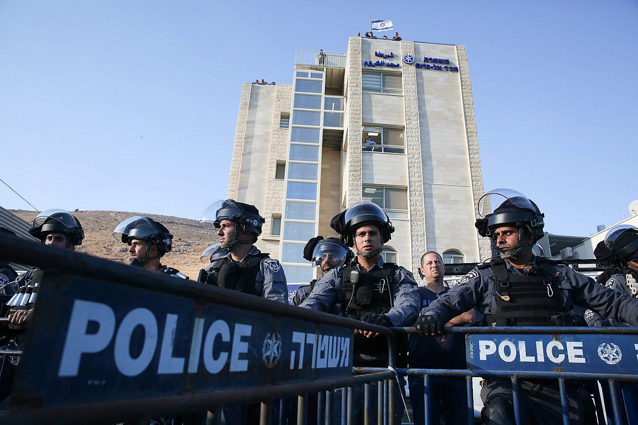 Israeli police at a protest attended by thousands of Palestinian citizens of Israel protesting against gun violence and organized crime in their communities, in the Palestinian town of Majd al-Krum in northern Israel, October 3, 2019. (David Cohen/Flash90)
