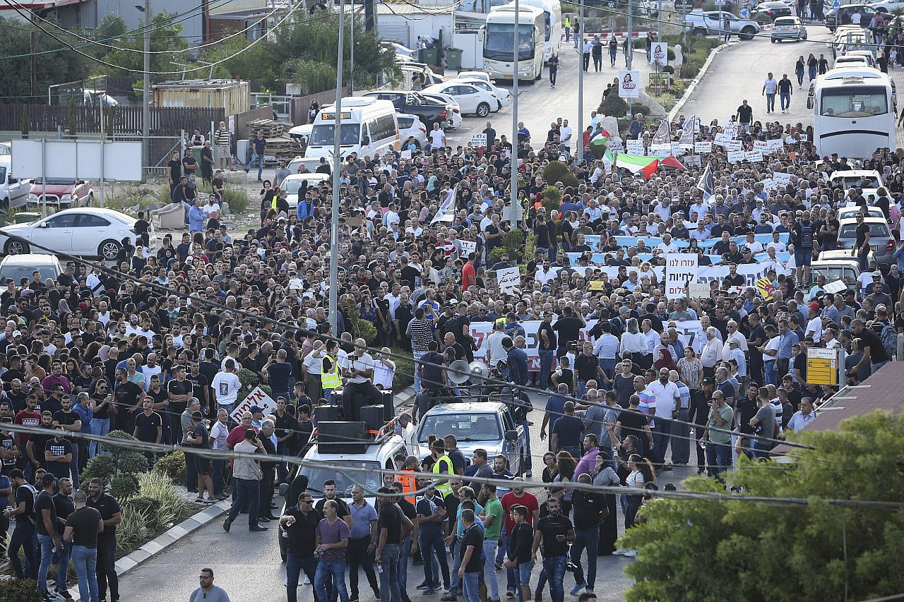 Thousands of Palestinian citizens of Israel protest against gun violence and organized crime in their communities, in the Palestinian town of Majd al-Krum in northern Israel, October 3, 2019. (David Cohen/Flash90)