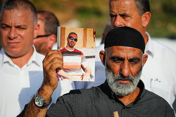 Palestinian citizens of Israel protest outside the Prime Minister's Office in Jerusalem against gun violence and organized crime in their communities, October 10, 2019. (Yonatan Sindel/Flash90)