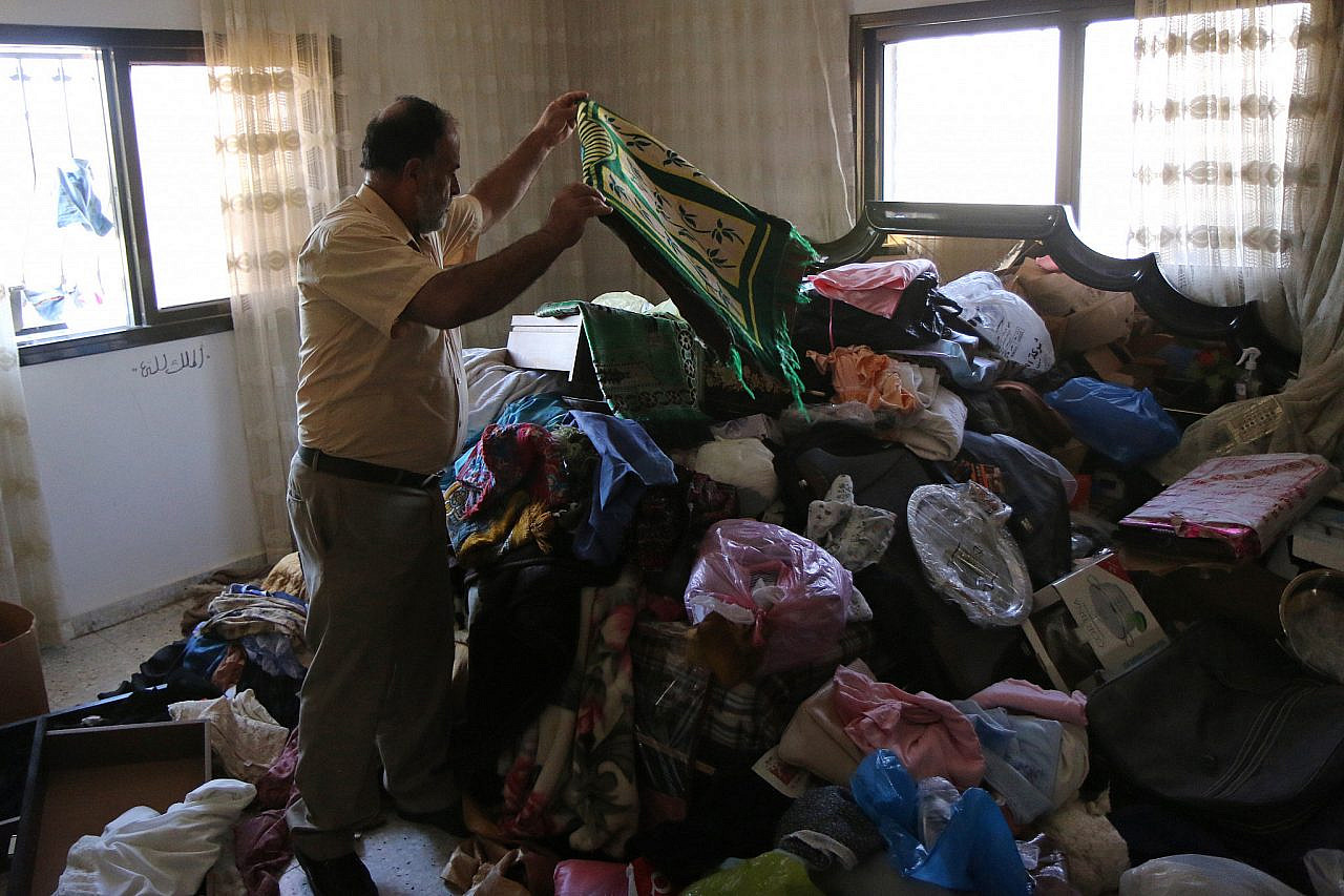 A Palestinian examines the damage in his house after an Israeli night raid in the village of Salem, near Nablus, West Bank, August 26, 2015. (Activestills.org)