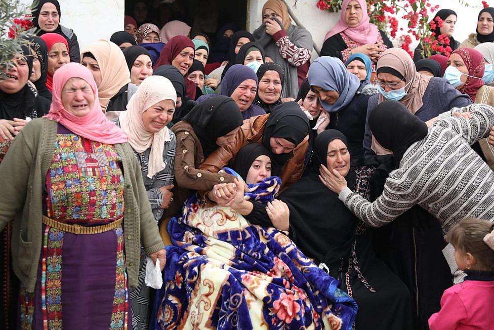Mourners at the funeral of of Ali Abu Aliya, 15, who was shot dead by Israeli soldiers on Dec. 4, al-Mughayyer, occupied West Bank, Dec. 5, 2020. (Oren Ziv)