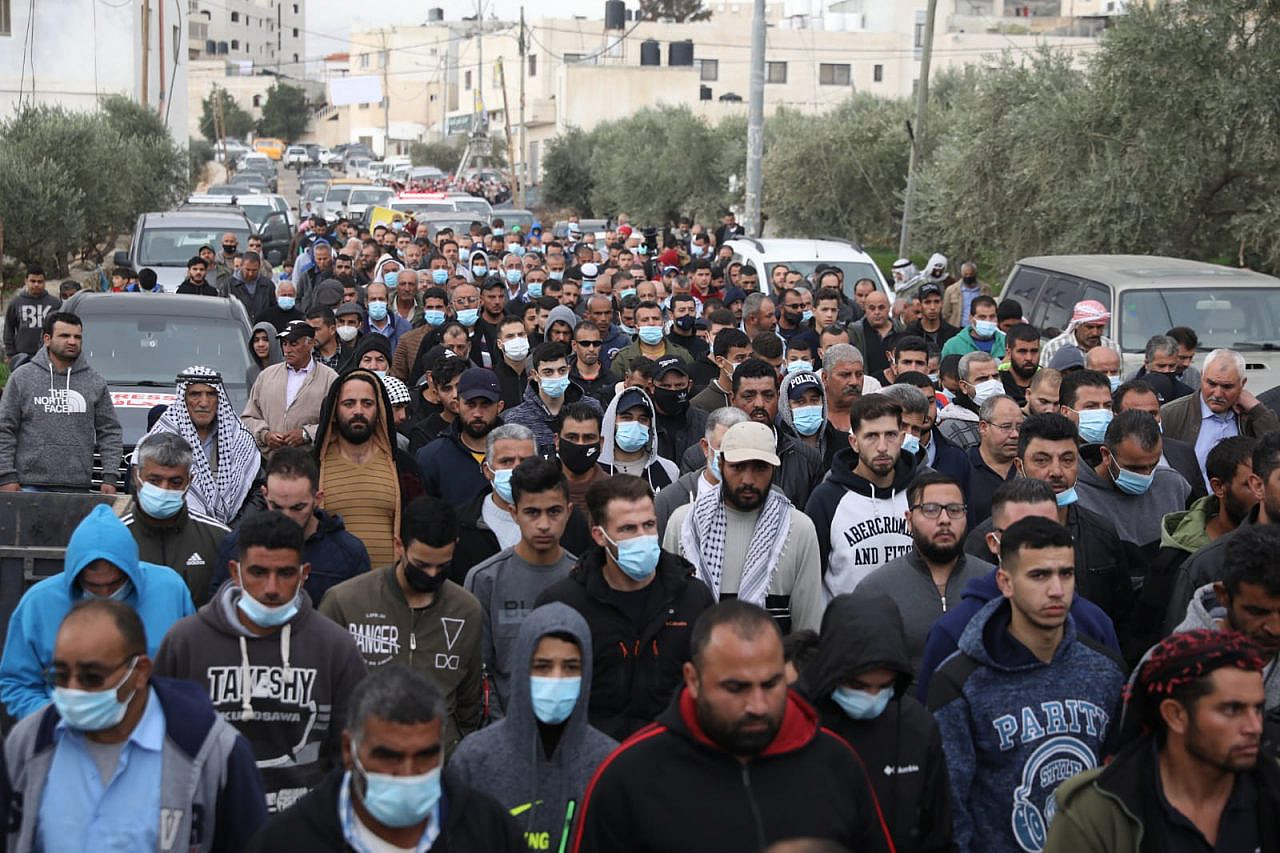 Mourners at the funeral of of Ali Abu Aliya, 15, who was shot dead by Israeli soldiers on Dec. 4, al-Mughayyer, occupied West Bank, Dec. 5, 2020. (Oren Ziv/Activestills)