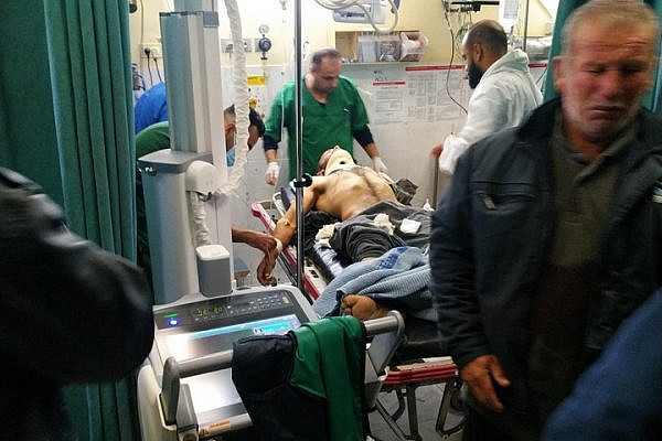 Harun Abu Aram seen in a Hebron hospital after being shot in the neck by an Israeli soldier. (Alliance for Human Rights)