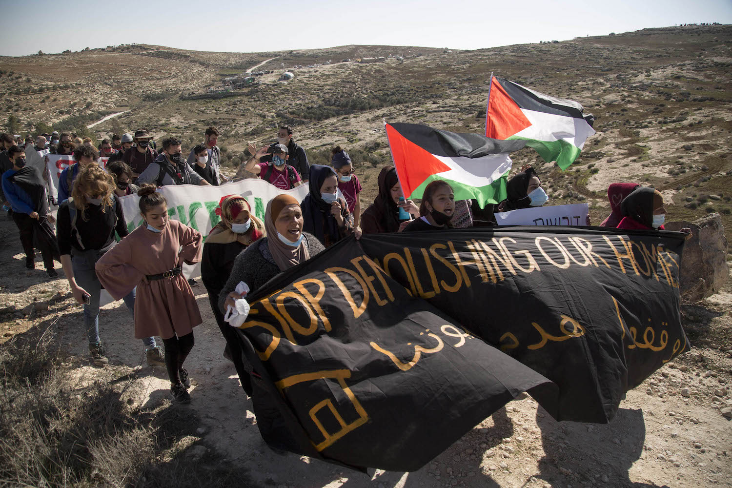 Palestinians and Israeli activists demonstrate against home demolitions and settler violence in the village of Al-Rakiz, South Hebron Hills, West Bank, January 8, 2021. (Keren Manor/Activestills.org)