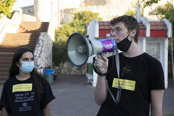 Conscientious objectors Shahar Peretz (left) and Daniel Peldi at an anti-annexation protest in the city of Rosh Ha'ayin June 2020. (Oren Ziv)