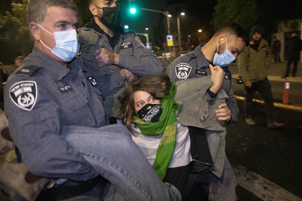 Israeli police arrest an anti-Netanyahu demonstrator during a protest outside the Prime Minister's Residence in Jerusalem, December 27, 2020. (Oren Ziv)