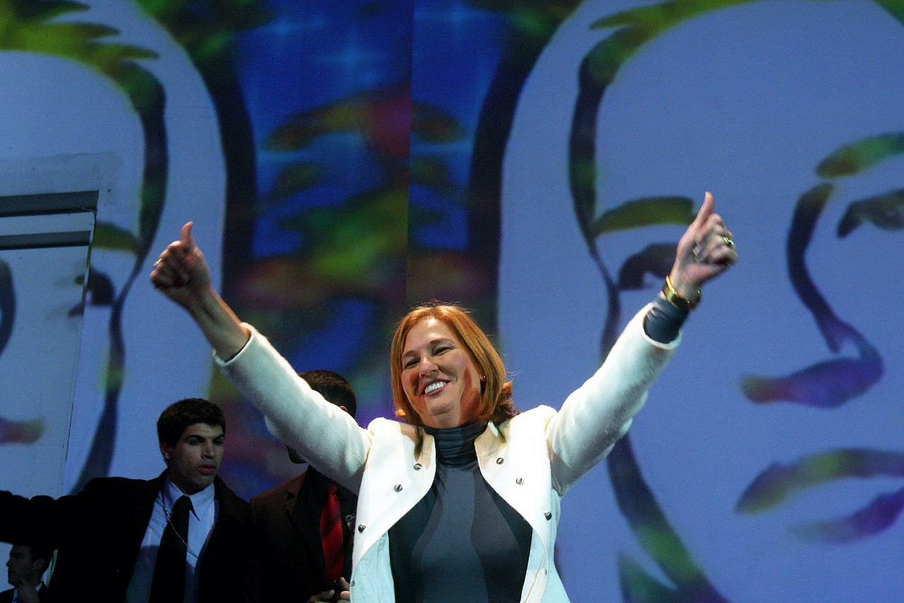 Kadima party leader Tzipi Livni waves to supporters during a rally in Tel Aviv on February 17, 2009. Livni's party edged out Benjamin Netanyahu's Likud in Israel's election, winning 28 seats to his 27. But after failing to form a majority coalition, Netanyahu ended up forming a government. (Roni Schutzer/Flash90)