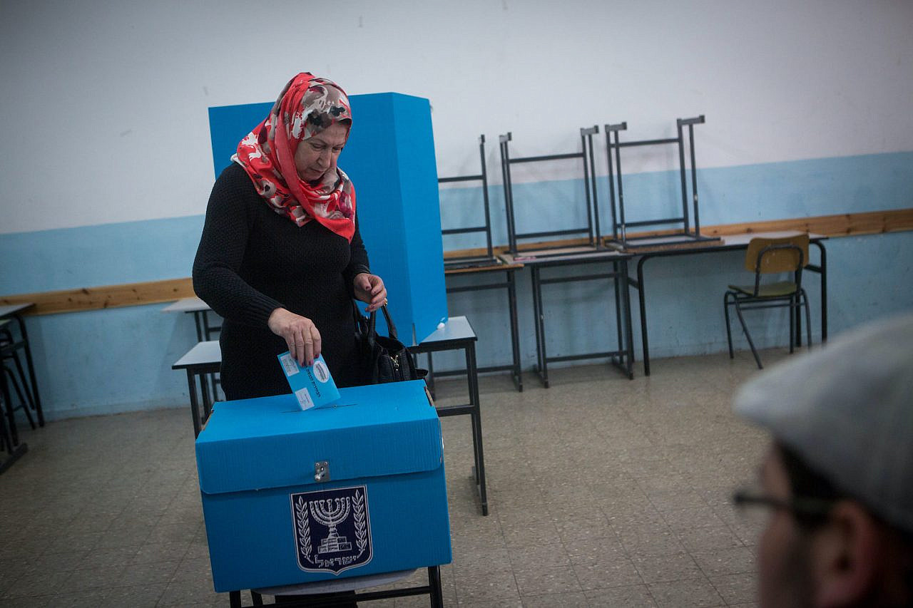A Palestinian citizen of Israel casts her vote in the Knesset elections at a polling station in the Palestinian town of Beit Safafa, on March 17, 2015. (Miriam Alster/Flash90)