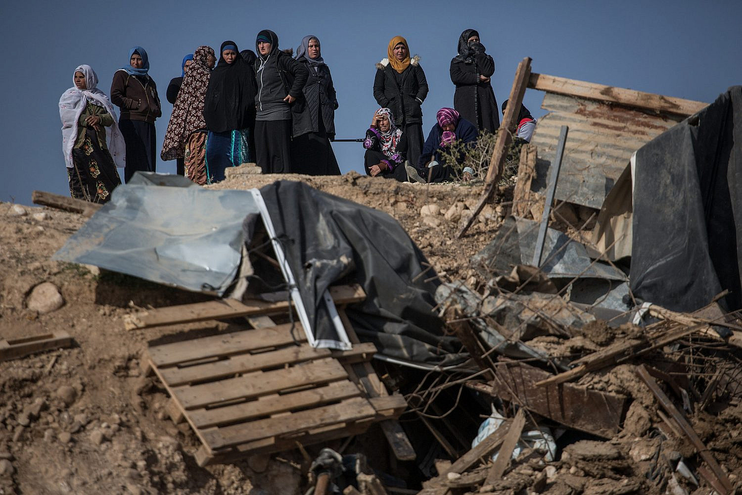 Bedouin women react after seeing their demolished home in the village of Umm al-Hiran in the Negev, southern Israel, Jan. 18, 2017. (Hadas Parush/Flash90)