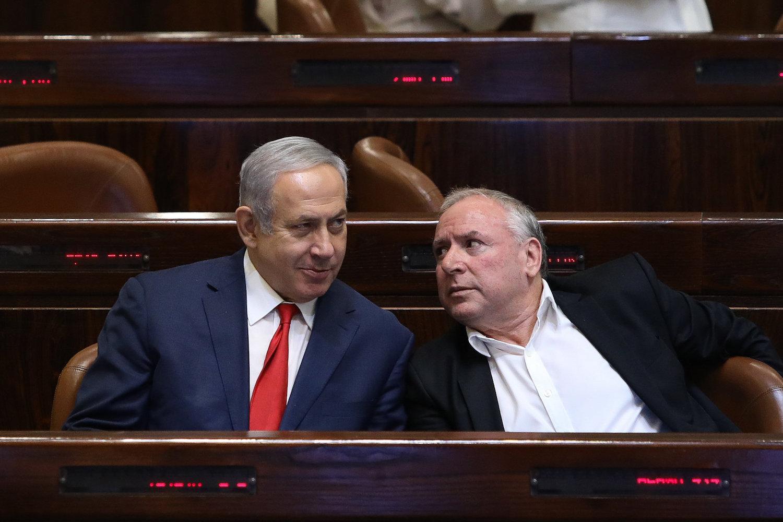 Prime Minister Benjamin Netanyahu and MK David Amsalem in the Knesset, Jerusalem, July 3, 2018. (Noam Revkin Fenton/Flash90)