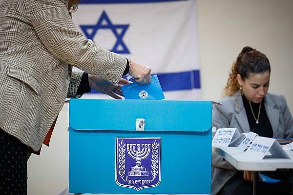 A woman casts her ballot in the Knesset elections at a voting station in Jerusalem, on March 2, 2020. (Olivier Fitoussi/Flash90)