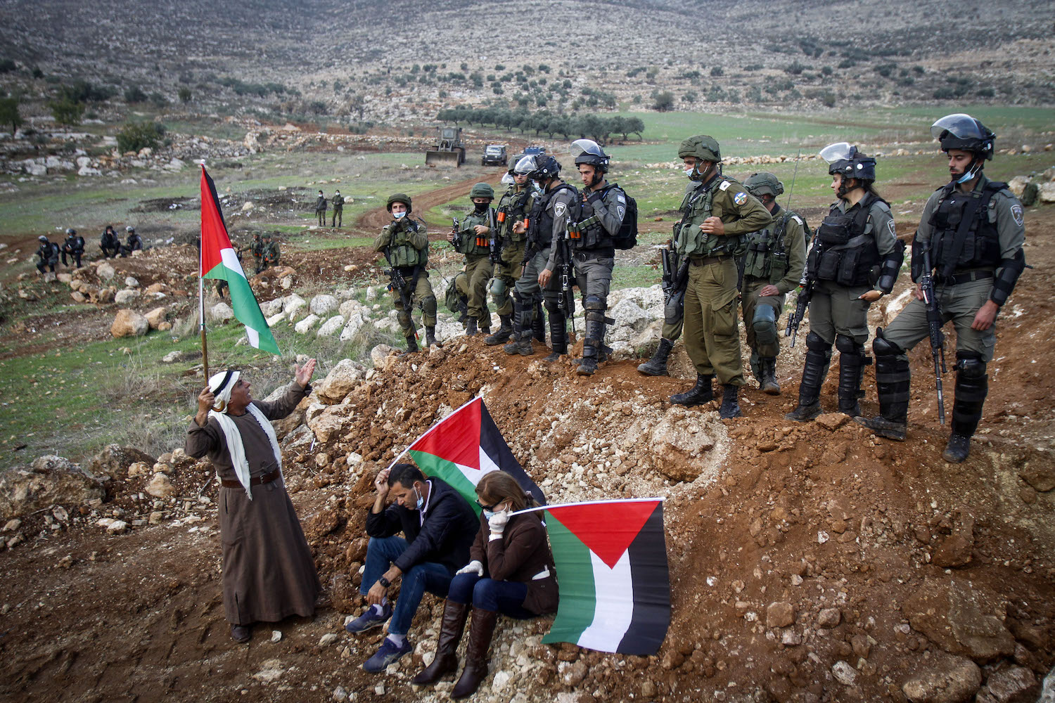 Palestinians hold a protest against a new settlement outpost near the village of Beit Dajan, West Bank, November 27, 2020. (Nasser Ishtayeh/Flash90)