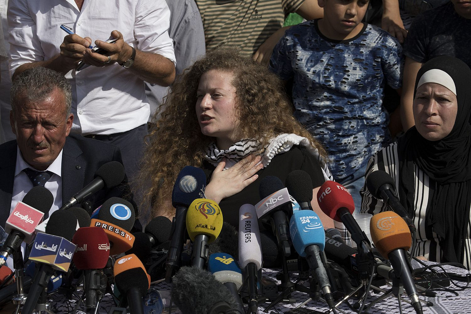 Ahed Tamimi with her family speaking to the press in Nabi Saleh, the West Bank, after her release from Israeli prison, July 29, 2018. (Oren Ziv)