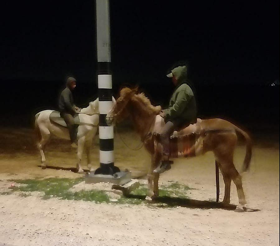 Settlers on horseback who came to watch Arik Ascherman's vehicle, after unknown individuals sabotaged it (Arik Ascherman)