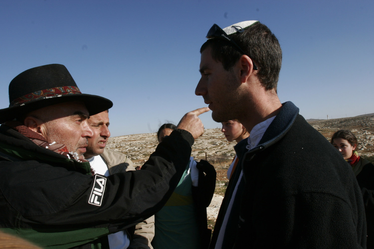 Ezra Nawi confronts an israeli settler during protest against settlement expansion and land grabs in Susya, West Bank, January 13th, 2007. (Oren Ziv/Activestills.org)