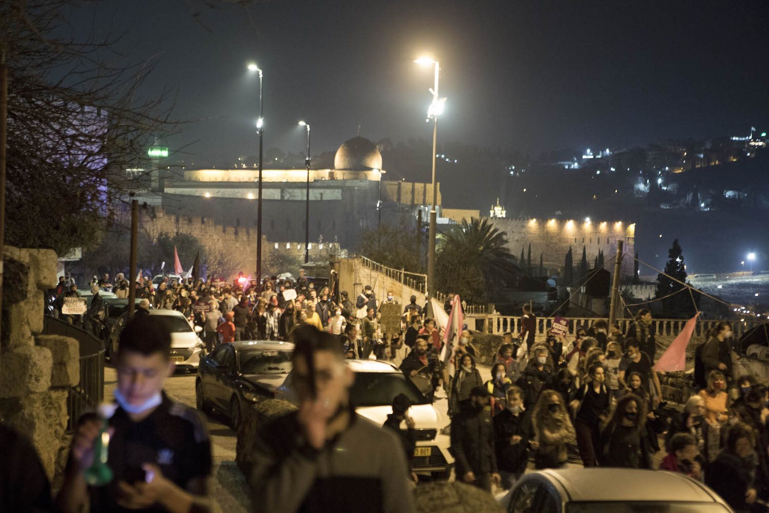 Hundreds of Palestinians and Israelis march from Silwan in East Jerusalem to the Prime Minister's Residence, February 6, 2021. (Keren Manor/Activestills.org)