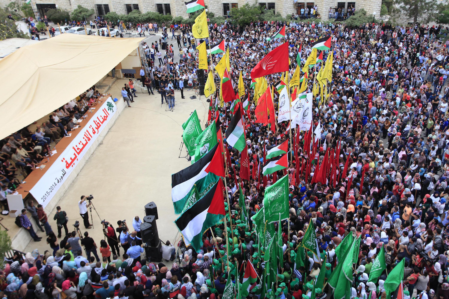 Palestinian students from the various political factions attend a rally prior to the Birzeit University student council elections, May 6, 2014. (Issam Rimawi/Flash90)