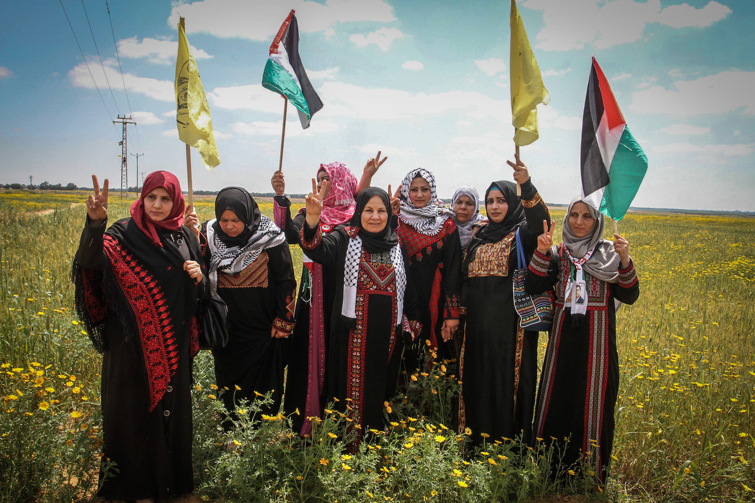 Palestinians take part in a demonstration on the anniversary of Land Day, near Khan Younis in the southern Gaza Strip, on March 30, 2016. (Abed Rahim Khatib/ Flash90)