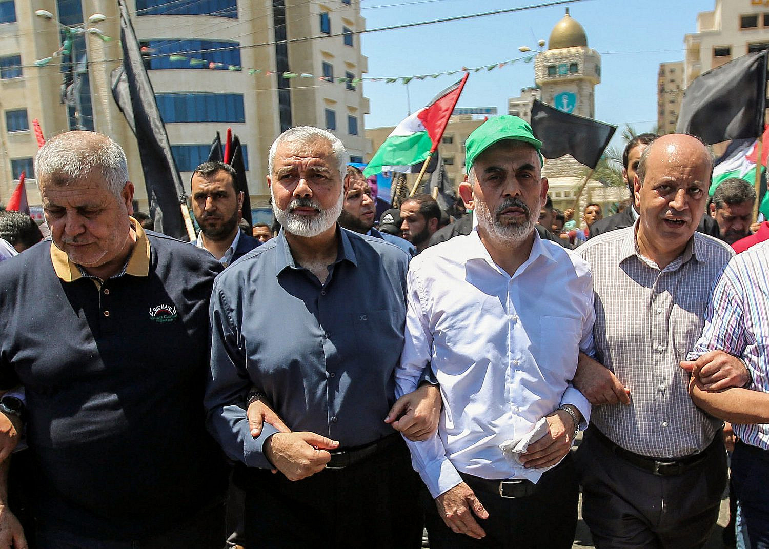 "Hamas leaders in the Gaza Strip Ismail Haniyeh and Yahya Sinwar march during a protest against US President Donald Trump's ""Deal of the Century"" and the ""Peace to Prosperity"" conference in Bahrain, in Gaza City, June 26, 2019. (Hassan Jedi/Flash90)"