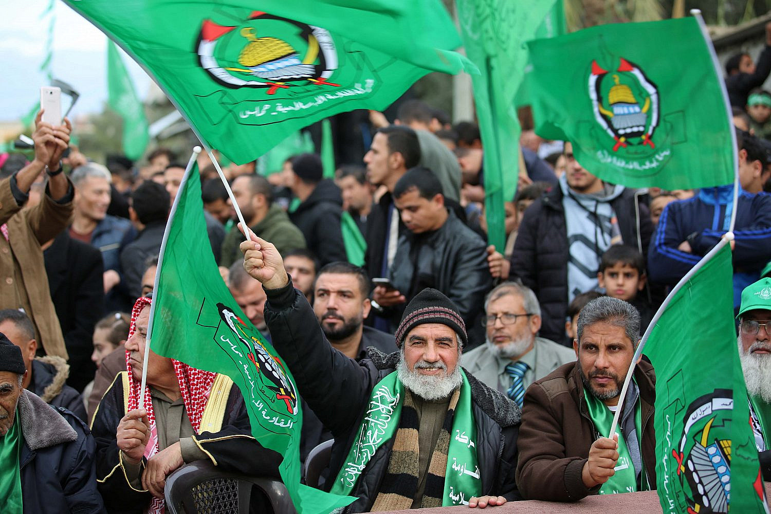 Palestinians attend a Hamas rally marking the 32nd anniversary of its founding in the Nusseirat camp in central Gaza City, Dec. 15, 2019. (Hassan Jedi/Flash90)